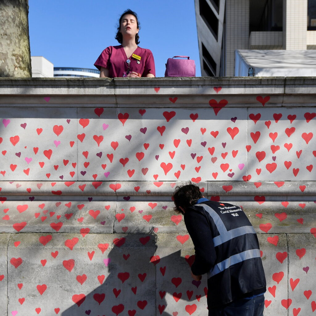 Covid mural being hand painted by grieving families